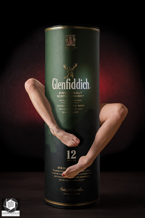 photo manipulation with glenfiddich whiskey and a woman's legs